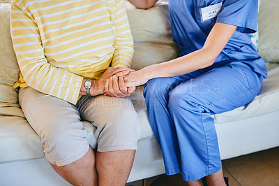 Buy stock photo Closeup shot of an unrecognisable nurse holding a senior woman's hand