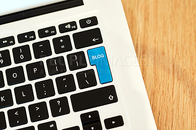 Buy stock photo High angle shot of a highlighted key of a blogger's laptop on a desk during the day