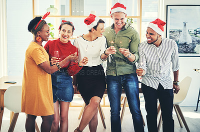 Buy stock photo Shot of a group of creative businesspeople holding up sparklers and celebrating together at their office Christmas party