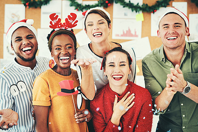 Buy stock photo Portrait of a group of creative businesspeople celebrating and having fun together at their office Christmas party