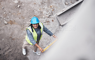 Buy stock photo High angle portrait of an attractive young female construction worker working on site
