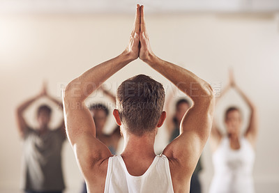 Buy stock photo Rearview shot of a group of young people working out together in a yoga class