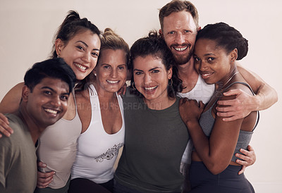 Buy stock photo Portrait of a group of active young people posing together against a wall in yoga class