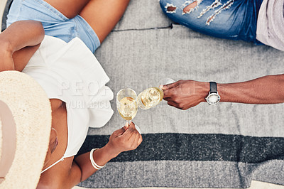 Buy stock photo Cropped shot of an unrecognizable couple having champagne on the beach