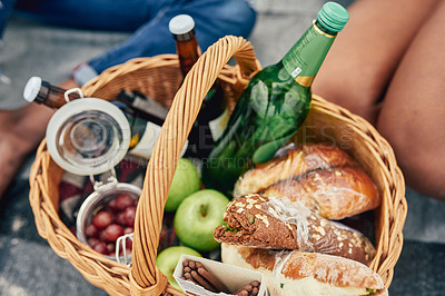 Buy stock photo Cropped shot of a picnic basket filled with snacks on the beach