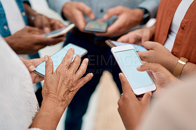 Buy stock photo Cropped shot of an unrecognizable group of businesspeople standing together and using their cellphones