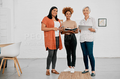 Buy stock photo Portrait of a group of businesswomen having an informal meeting in a modern office