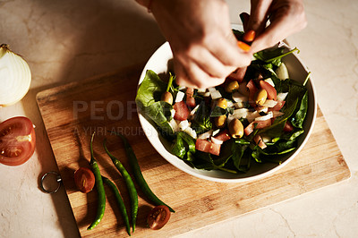 Buy stock photo Cropped shot of a woman preparing a healthy salad at home