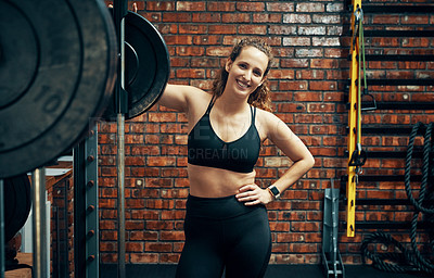 Buy stock photo Cropped shot of a beautiful young woman out for a session at the gym