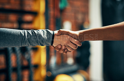 Buy stock photo Cropped shot of two unrecognizable people shaking hands in a gym
