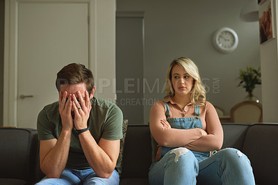 Buy stock photo Shot of a young couple having a disagreement at home