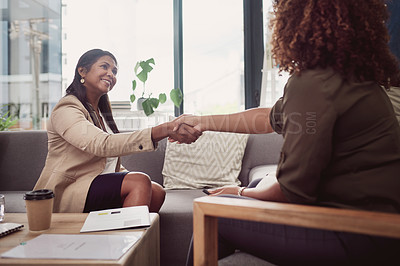 Buy stock photo Shot of a mature businesswoman shaking hands with a colleague in an office