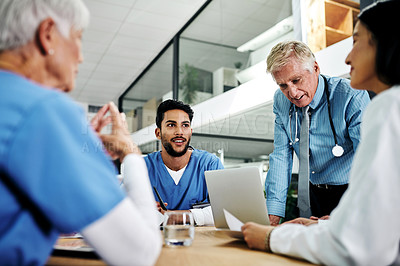 Buy stock photo Cropped shot of a diverse group of medical practitioners having a meeting in a hospital