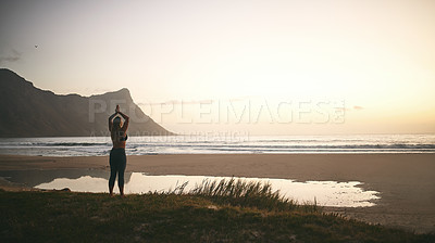 Buy stock photo Full length shot of an unrecognizable woman standing alone and meditating during a relaxing day outdoors