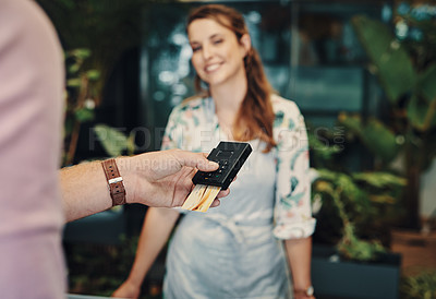 Buy stock photo Cropped shot of an unrecognizable man using his credit card to purchase from a florist