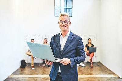 Buy stock photo Portrait of a young businessman using a laptop while standing in front of candidates who are waiting in line