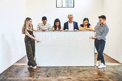 Buy stock photo Shot of a group of businesspeople holding a blank board in an office