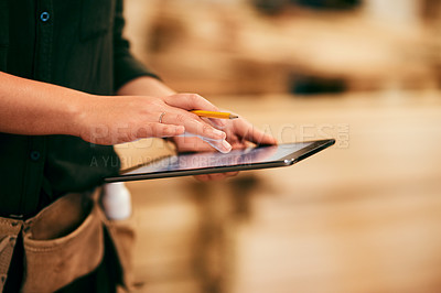 Buy stock photo Shot of a an unrecognizable carpenter using a digital tablet in her workshop