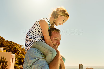 Buy stock photo Shot of an adorable little girl having a fun day outdoors with her father
