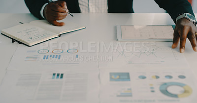 Buy stock photo Cropped shot of an unrecognizable businessman writing on a notepad while strategizing and planning inside his office