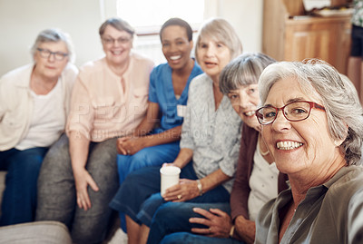 Buy stock photo Cropped portrait of a happy senior woman taking a selfie with her friends and nurse in the living room