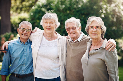 Buy stock photo Cropped portrait of a group of seniors standing together and bonding during a day out in the garden
