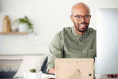 Buy stock photo Cropped shot of a young businessman sitting behind a computer in his office