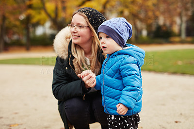 Buy stock photo Cropped shot of an adorable little boy looking shocked while spending time with his mother in a park in autumn