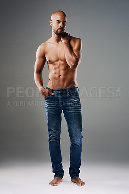 Buy stock photo Full length shot of a handsome young man posing shirtless against a grey background