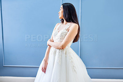 Buy stock photo Cropped shot of a beautiful young bride wearing her wedding gown in her dressing room