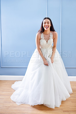 Buy stock photo Full length portrait of a beautiful young bride smiling while wearing her wedding gown in her dressing room