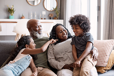Buy stock photo Shot of two adorable young siblings bonding and spending time with their grandparents at home