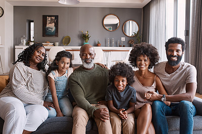 Buy stock photo Portrait of a beautiful multi-generational family posing together on a sofa at home