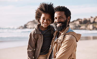 Buy stock photo Shot of an adorable little boy having a fun day at the beach with his father