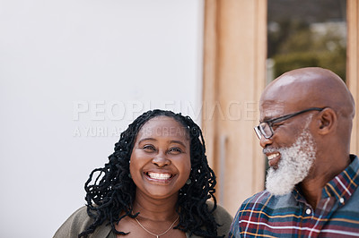 Buy stock photo Portrait of a mature woman standing alongside her husband outside their home