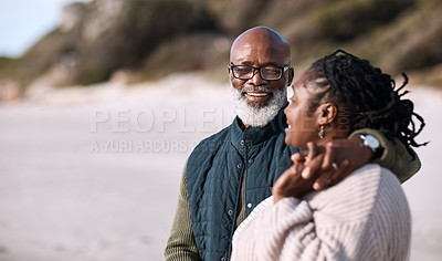 Buy stock photo Shot of a happy mature couple spending a romantic day at the beach