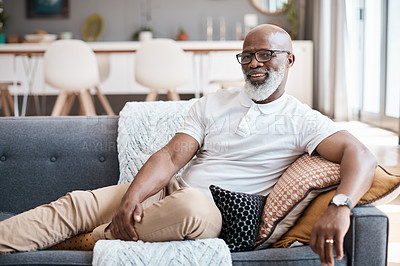 Buy stock photo Portrait of a mature man relaxing on a sofa at home