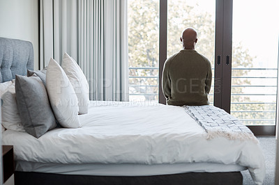 Buy stock photo Rearview shot of a mature man looking through a window in a bedroom at home