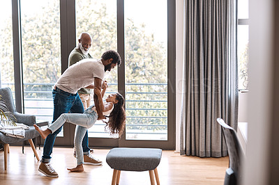 Buy stock photo Full length shot of an adorable little girl dancing with her father and grandfather at home