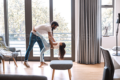 Buy stock photo Full length shot of an adorable little girl dancing with her father at home