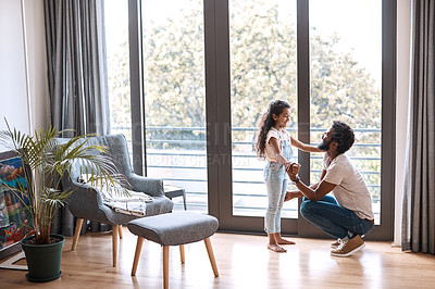 Buy stock photo Full length shot of an adorable little girl dancing and spending time with her father at home