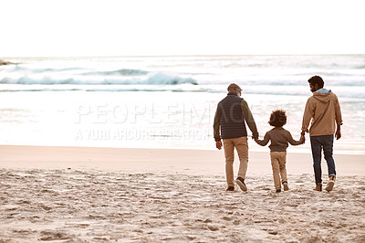Buy stock photo Rearview shot of an adorable little boy spending time at the beach with his grandfather and father