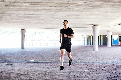 Buy stock photo Full length shot of a handsome young male athlete working out in the city