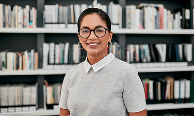 Buy stock photo Cropped portrait of an attractive young female architect smiling while standing in her office