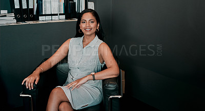 Buy stock photo Cropped shot of a young businesswoman sitting in an office