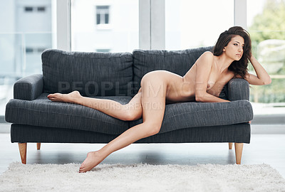 Buy stock photo Full length shot of a gorgeous young woman lying down nude on her couch at home