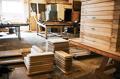 Buy stock photo Still life shot of piles of wood stacked inside a carpentry workshop