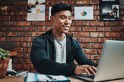 Buy stock photo Cropped shot of a handsome young male fitness instructor using a laptop while working in a gym