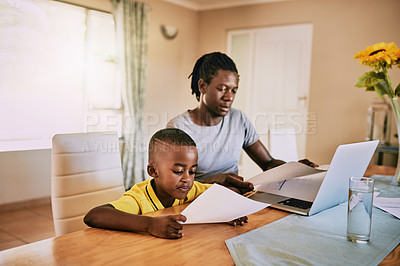 Buy stock photo Cropped shot of an adorable little boy looking at his father's paperwork at home