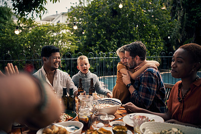 Buy stock photo Shot of an adorable little girl hugging her father during a dinner party with friends outdoors